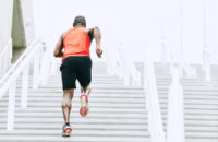 athlete runs up stairs in city
