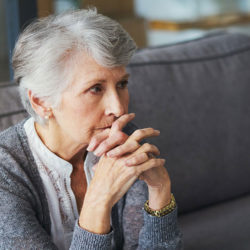 woman upset sitting on couch