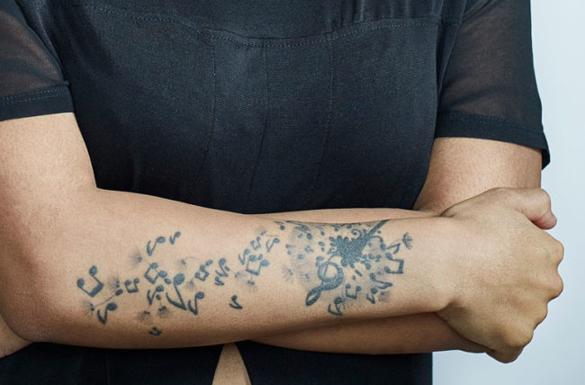 woman with tattoos on arm