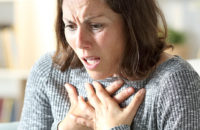 woman frightened with chest pain