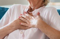 woman suffering with chest pain