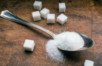 tablespoon of sugar and sugar cubes