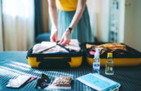 woman packing suitcase for vacation