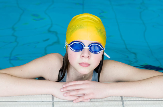 young swimmer with swimming cap and eye goggles