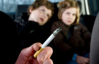 children in car suffering from secondhand smoke