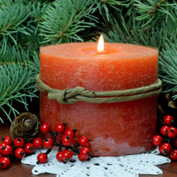 scented buring candle and evergreens