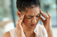 woman suffering from a migraine
