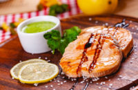 salmon steak on plate wtih lemons