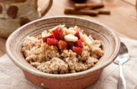a bowl of oatmeal topped with fruit is good for lowering cholesterol