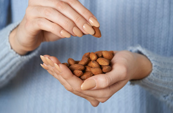woman snacking on almonds