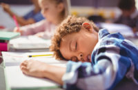Child asleep in class