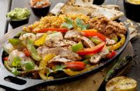 Mexican food on a platter beans rice vegetables meat