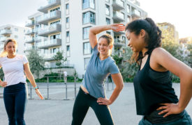 Women beginning their exercise routine outside