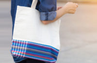 woman carrying tote bag ready for cancer treatment