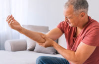 Older man suffering from a painful elbow