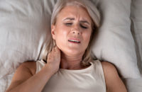 woman with painful neck after sleeping pillow