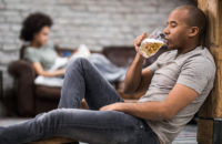 Man having a beer while relaxing at home