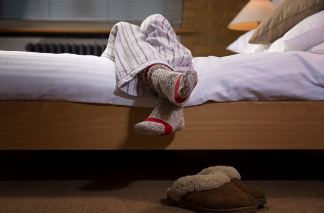 woman wearing socks to bed