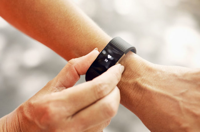 Woman checking her heart with her fitness tracker