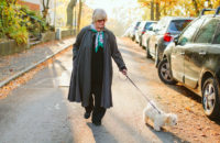 elderly womanwalking dog in afternoon