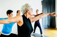 Older woman with leukemia in yoga class