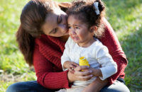 mother consoling crying two year old