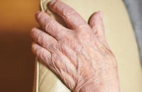 aged hands with crepey skin