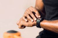 Mann checking smart watch for heart rate