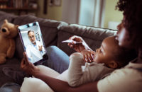Mom with sick baby virtual appointment with doctor