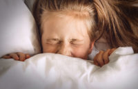 child frightened in bed with night terrors