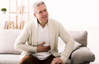 Older man with digestive discomfort