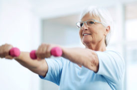 elderly woman lifting hand weights