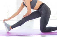 Woman stretching hips and legs during yoga