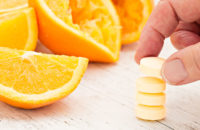 man taking vitamin c to stave off cold