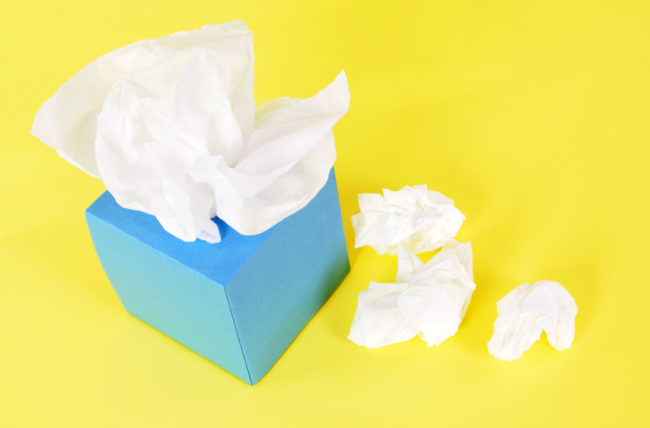 Surprising Relief for Your Stuffy Nose? Have Sex | Photo of blue tissue box with crumpled tissues beside it