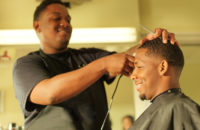 What Happened When Barbers Helped Black Men With High Blood Pressure | man getting his hair cut at barber shop and smiling
