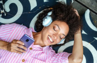 woman listening to music practicing mindfulness