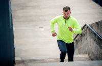Man running up stairs for cardio workout
