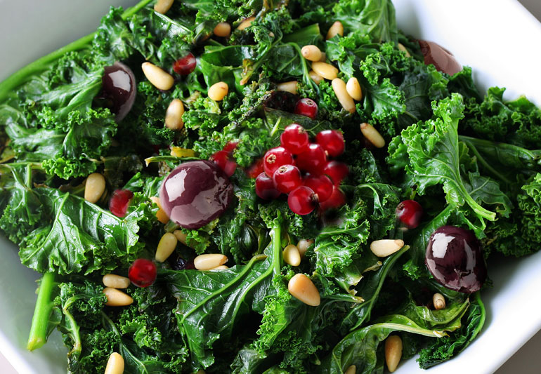 Raw Kale Salad With Pine Nuts, Currants + Kalamata Olives