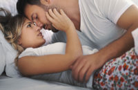 Couple in bed touching