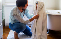 Mother drying her child with towel