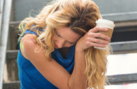 Woman with coffee feeling unwell possible Atril Fibrillation