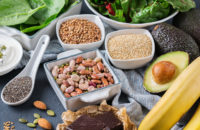 Magnesium rich foods including bananas, nuts, avocados and chocolate