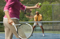 Older couple plays tennis