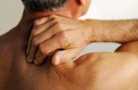 Man applying pressure point message to his neck