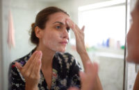 Woman adding probiotics to skin care regime