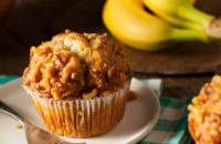 Banana nut muffin with bananas in background