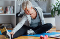 Older woman stretching and exercising to stave off osteoarthritis