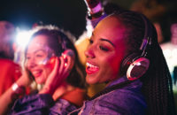 Women wearing headphones at concert