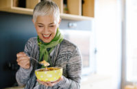 Older woman eats her breakfast of calcium fortified cereal with milk